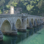 The Bridge on the Drina with construction in the back.